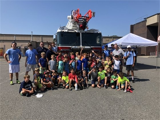 TMFD personnel at Hommocks Camp with campers for a fire department demo
