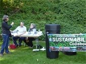 Volunteers from the Town's Sustainability Collaborative talking with resident, Sheldrake Fall Festival