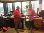 Sanitation Foreman Clarence Gaddis with the 1st Food Waste Customer!