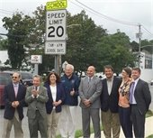 Officials at Unveiling of Reduced School Speed Zone sign