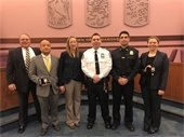 Chief Creazzo with newly sworn in and promoted police officers
